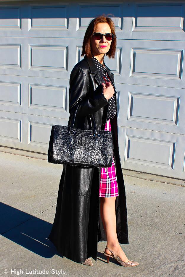 maxi leather coat over polka dot shirt A-line skirt
