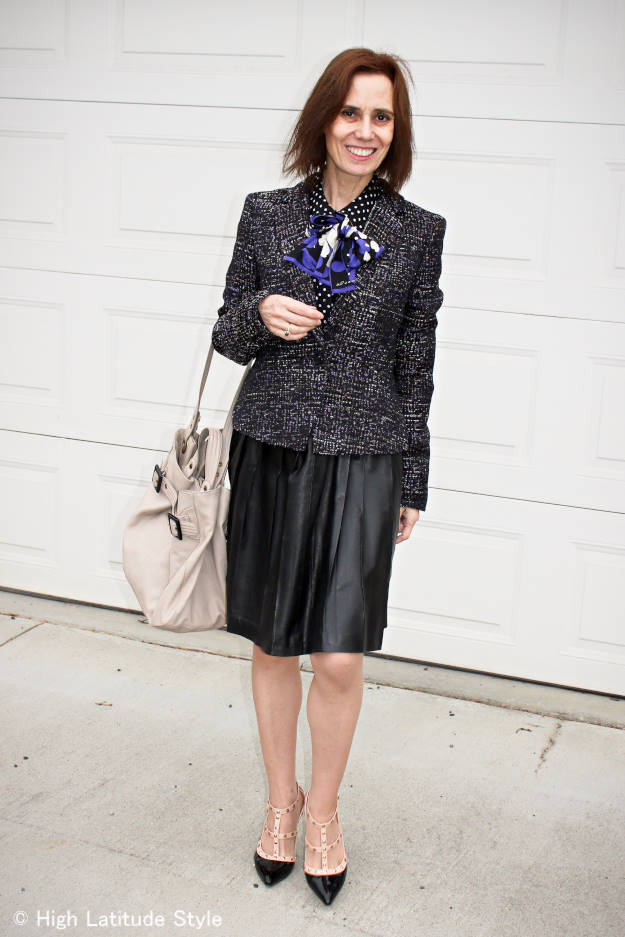 Alaska fashion blogger over 50 in black and white work outfit with pleated leather skirt and blazer