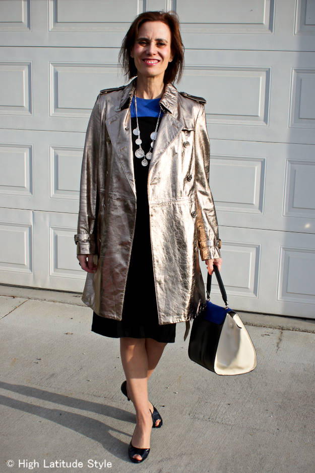 Midlife woman in posh chic golden trench coat
