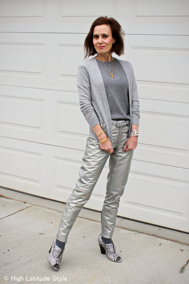 street style chic older woman in silver leather pants