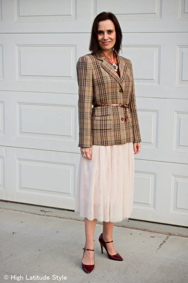 midlife woman in street style with plaid blazer and mesh skirt
