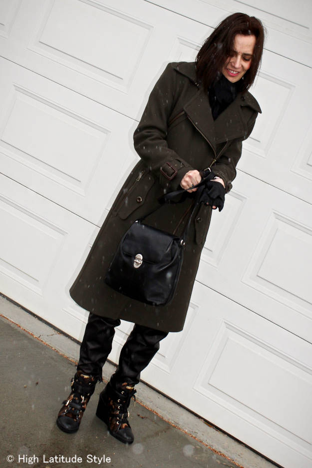 #fashionover40 mature woman in a belted motorcycle coat