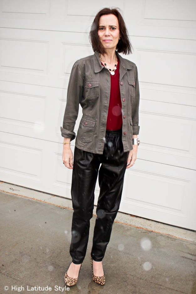 style book author in weekend style with leather joggers and utility jacket