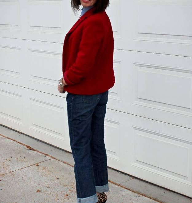 #midlifestyle #fashionover50 midlife woman in classic work outfit with red blazer, chambrary shirt, pumps, and jeans