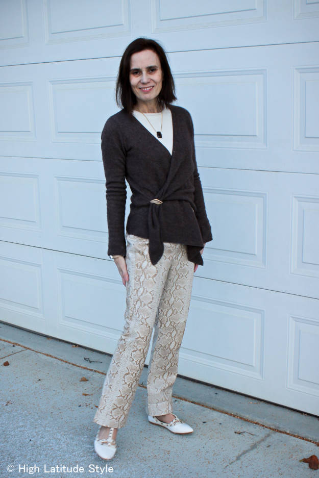 #over40fashion mature woman in leather pants, knit jacket closed with a brooch