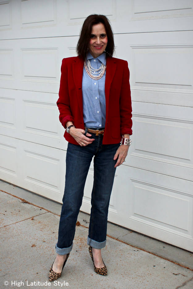 style blogger in classic work outfit of red blazer with jeans, shirt and pearls