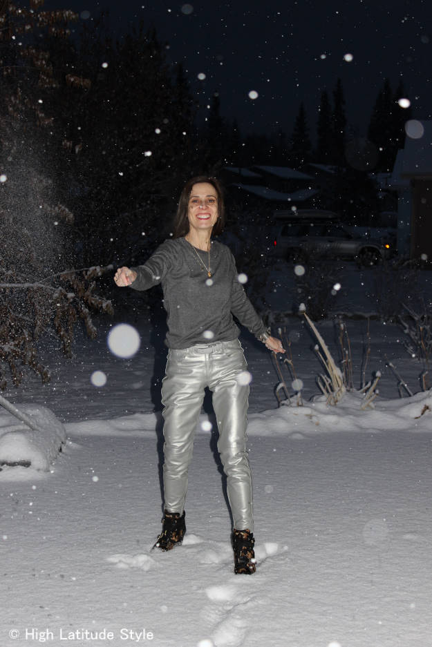 #fashionover40 woman wearing street style with silver leather pants, gray top and gold colored jewelry