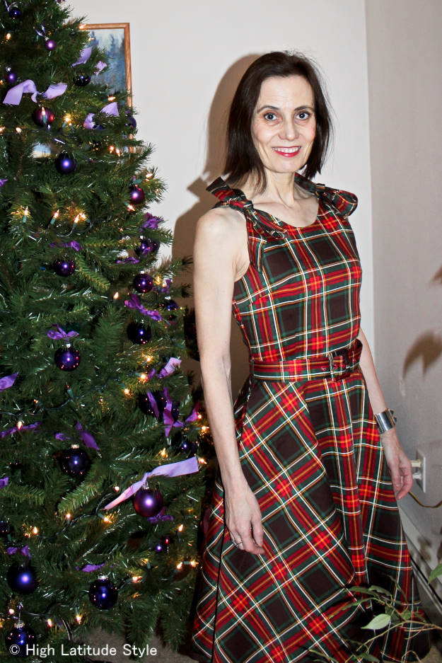 midlife style blogger in plaid holiday dress