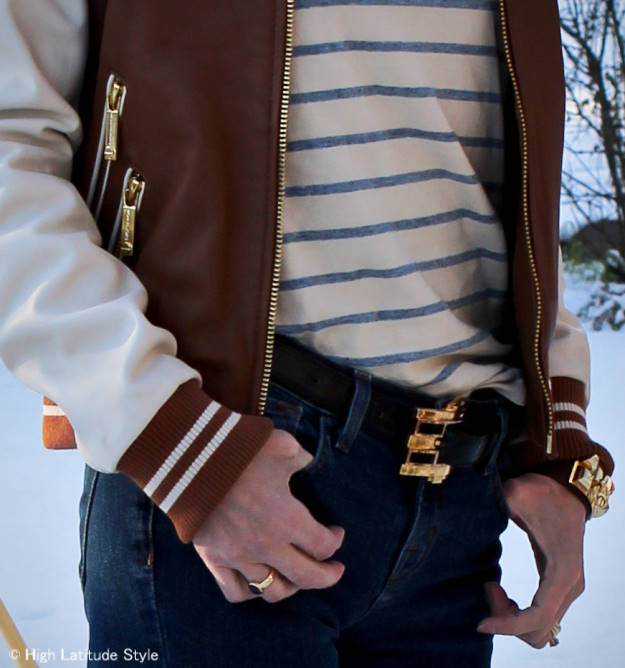 #fashionover50 details of baseball jacket and jewelry