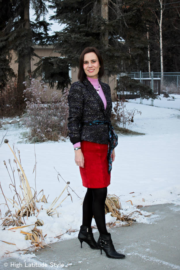 mature fashion blogger in work outfit with red suede skirt