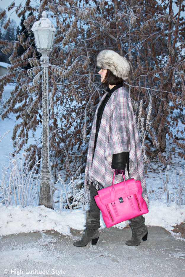 midlife style blogger with gray, white pink plaid blanket scarf over a coat