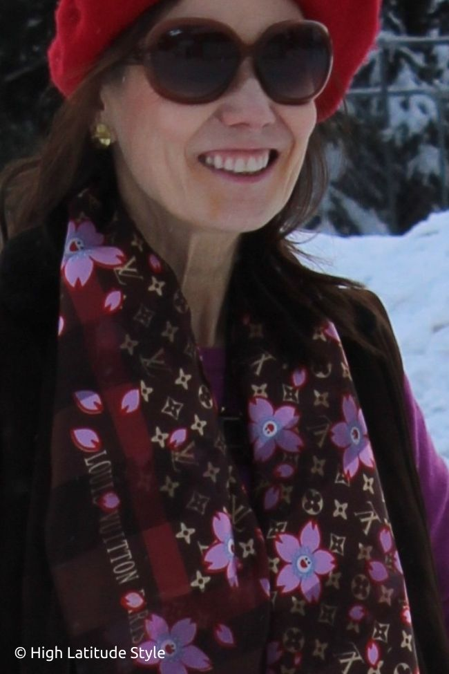 portrait with brown red pink and red beretblue scarf