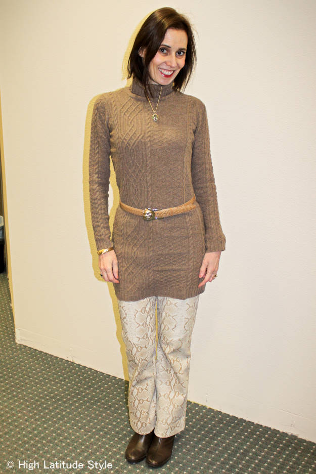 #fashionover40 #fashionover50 Fashion blogger looking ageless in the 70s trend with a brown snake print pants and mocha dress worn as sweater