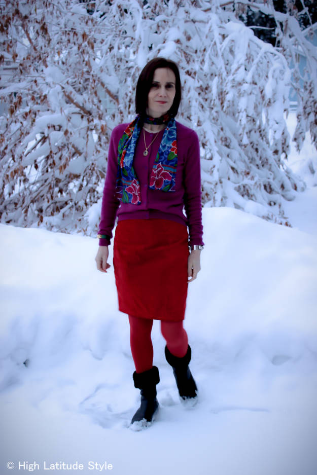 mature style blogger donning a color blocked winter work look with scarf