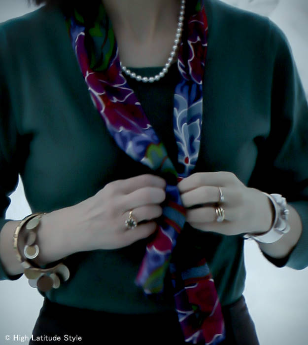 over 50 years old stylist featuring an Akoya pearl necklace in a classic way