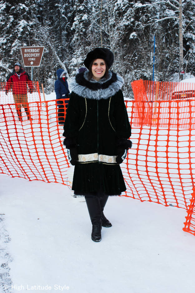 #over40fashion fashion blogger Nicole of High Latitude Style wearing a Kuspak parka when watching the Iditarod
