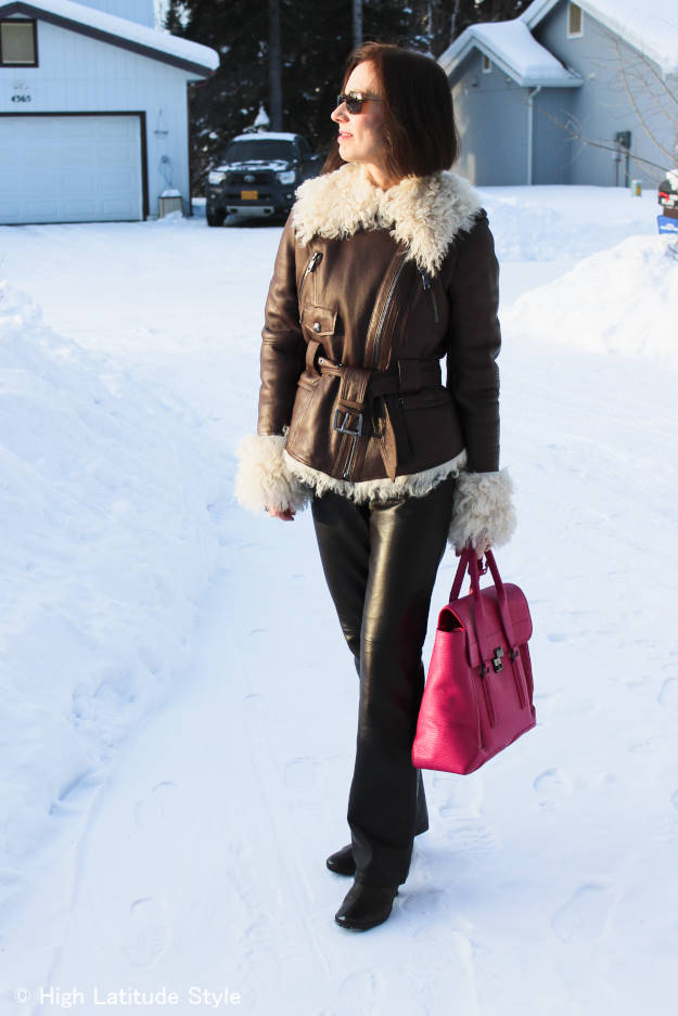 midlife woman in pants and shearling jacket