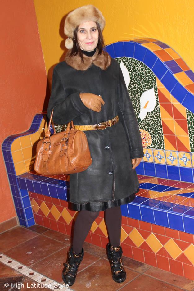 stylist in winter outerwear with heels