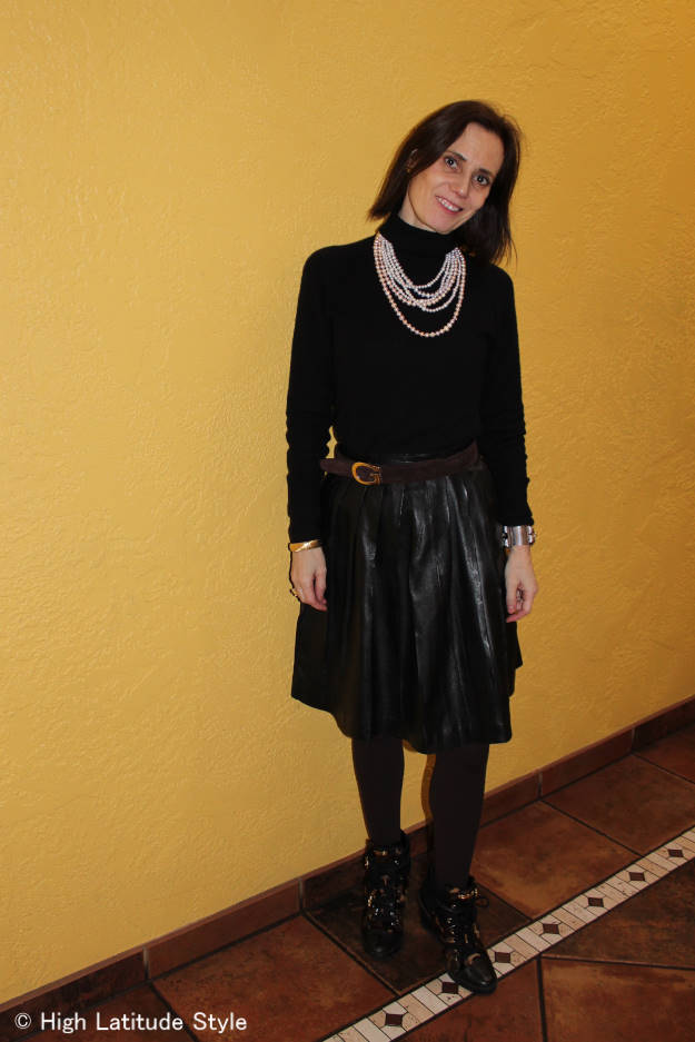 #fashionover40 midlife woman looking posh in a full leather skirt with wedge heels