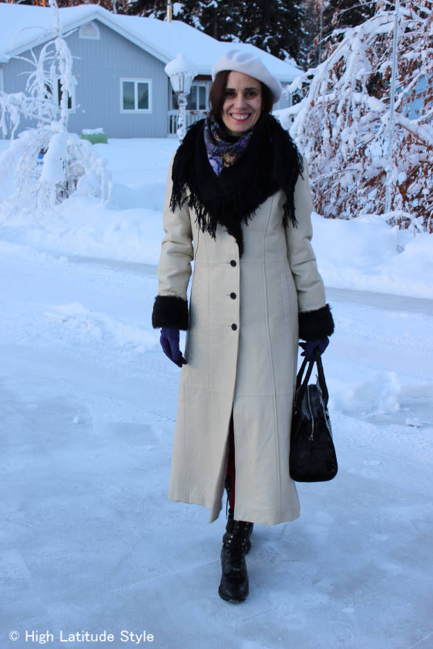 #over40fashion Nicole of High Latitude Style in white leather winter coat with faux fur details