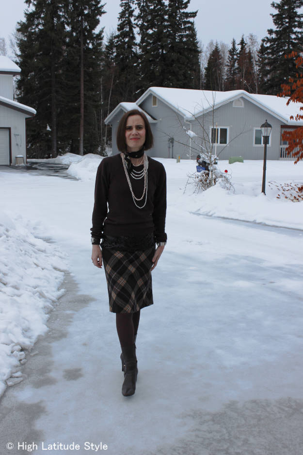 fashion blogger over 50 in a work outfit with sequins