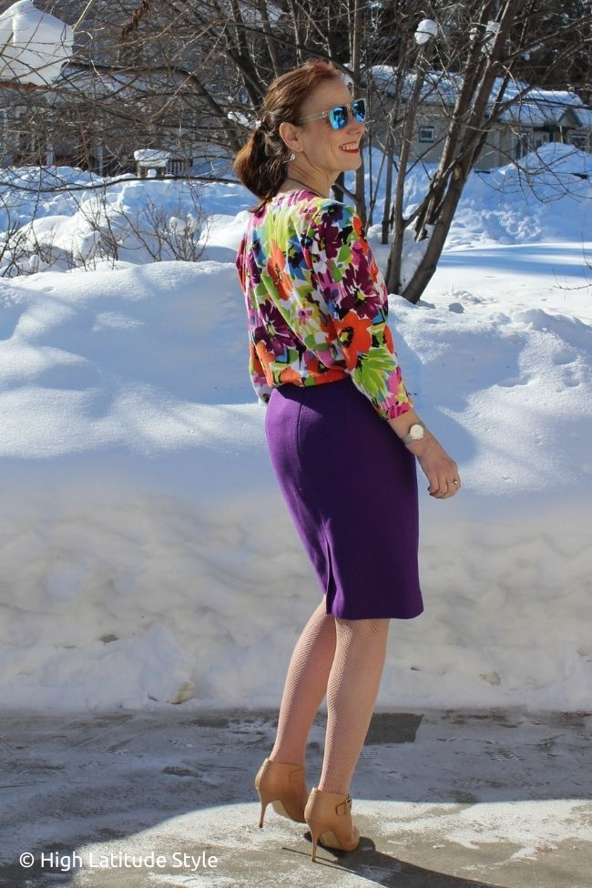 fashion blogger in floral top, purple pencil skirt, pantyhose, nude ankle strap pumps