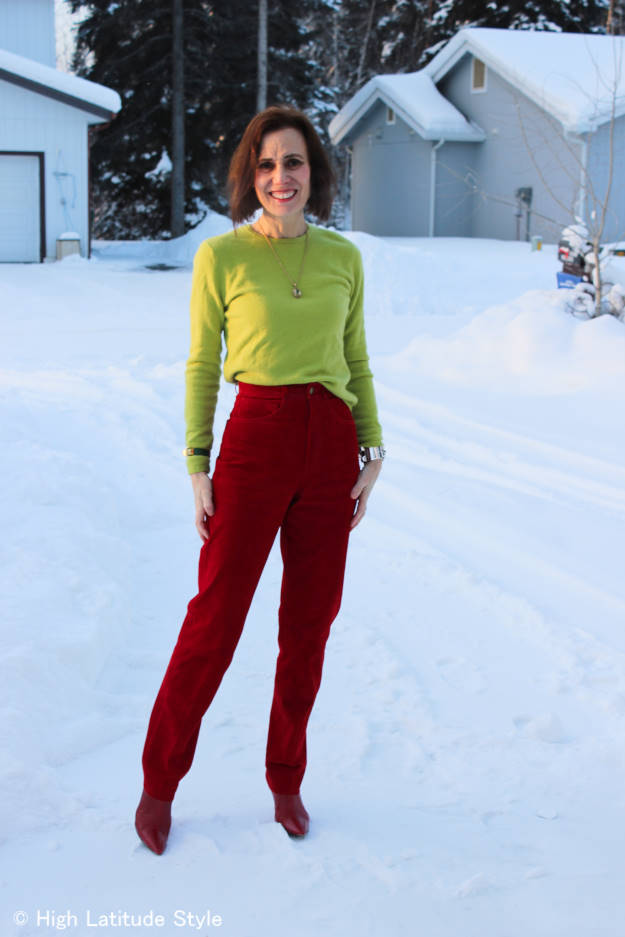 fashion blogger over over 50 in chartreuse sweater and red pants