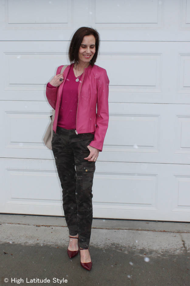 #midlifefashion over 40 year old woman wearing a leather biker with camouflage cargos