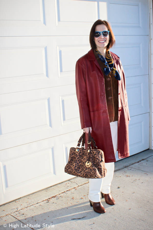 #fashionover50 woman in leather coat over suede jacket and leather pants