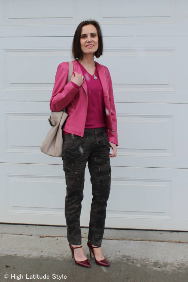 #over40fashion midlife woman wearing camouflage pants and a pink biker jacket