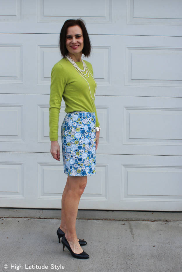 mature Alaskan woman in spring work outfit with floral skirt