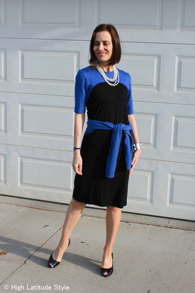 #midlifestyle woman in color block jersey dress styled for work