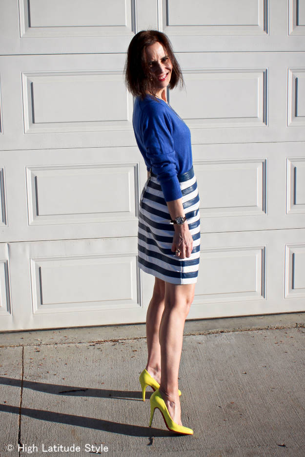 over 40 fashionista looking posh in a striped skirt sweater work look
