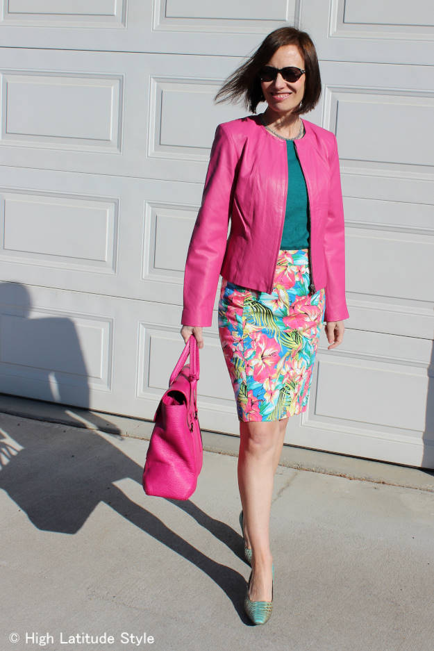 #fashionover50 woman in spring work outfit with tropical print skirt and sweater