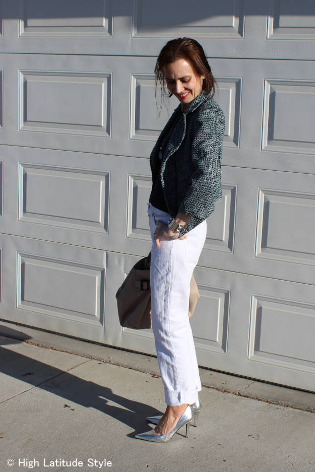 #over50fashion mature woman wearing metallic silver pumps with white jeans and a motorcycle jacket
