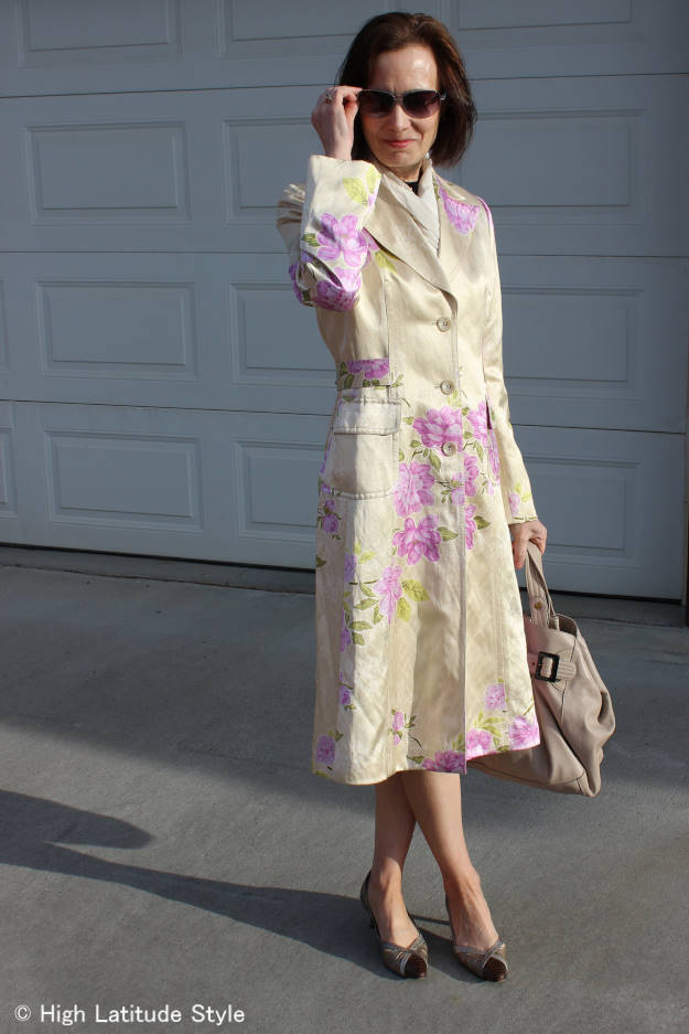 over 50 years old nuptial ceremony guest with silk floral coat to stay warm in the late afternoon