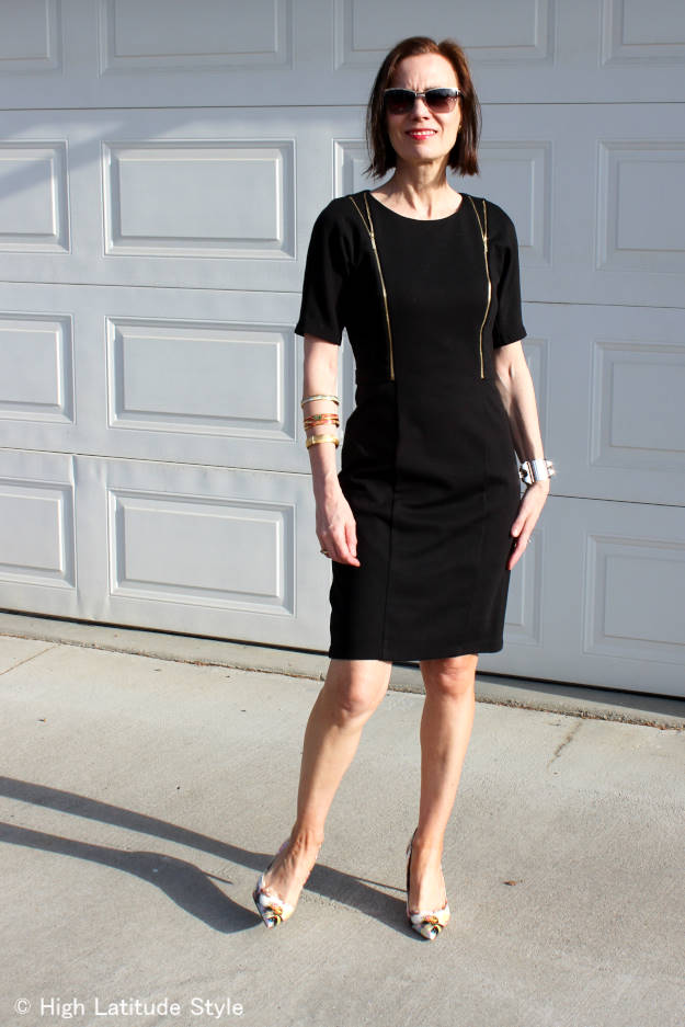 #fashionover50 styler blogger in LBD with zipper details, sunglasses and pumps