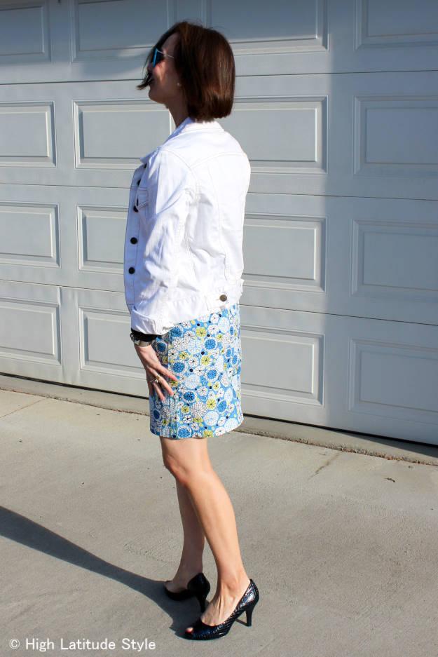 #fashionover50 white denim jacket with printed skirt