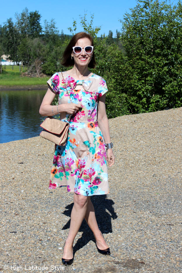 fashion blogger in abstract flowers dress