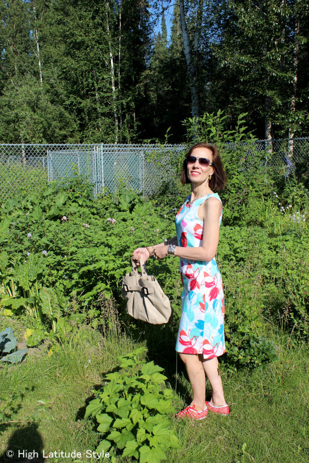#fashionover40 #over50fashion midlife woman in posh floral print dress with Keds for casual Friday and unique jewlry