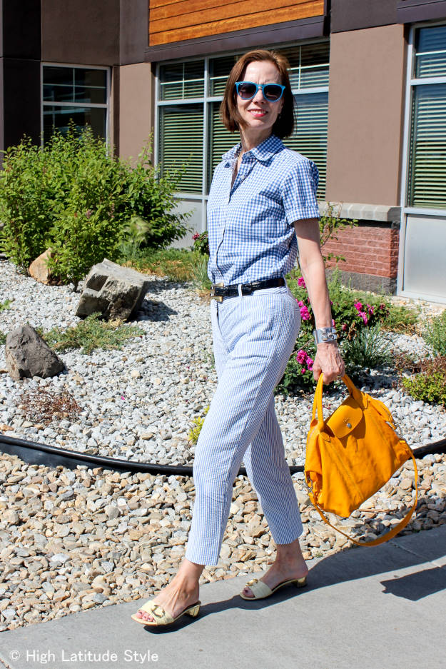 midlife fashionista in blue and white trend seersucker with gingham shirt work outfit