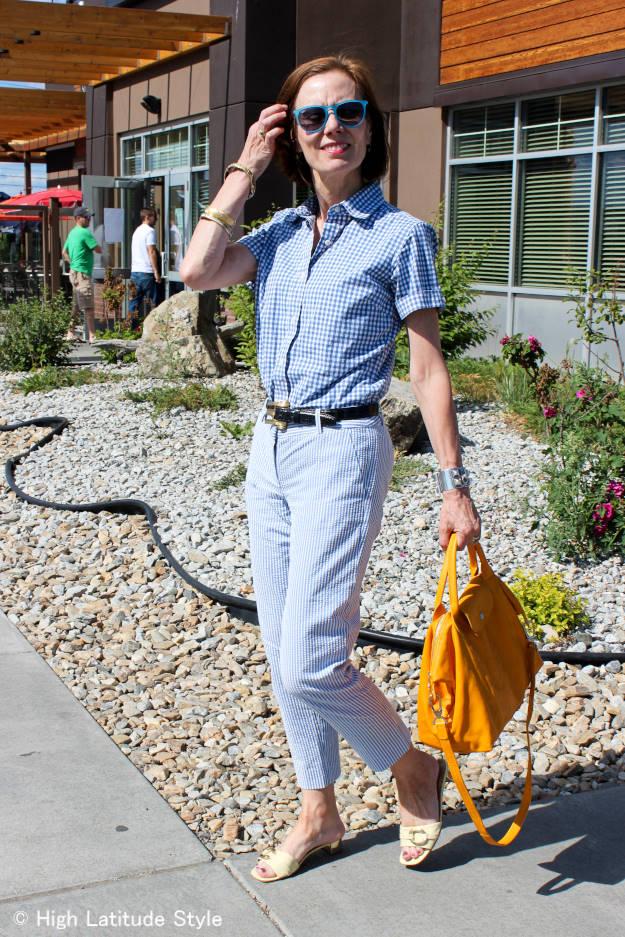 stylist in menswear seersucker pants and gingham button-down shirt