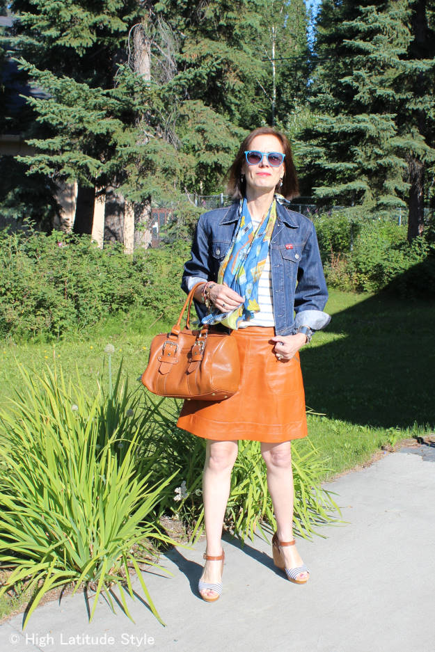 #fashionover40 #fashionover50 woman in denim jacket with leather skirt