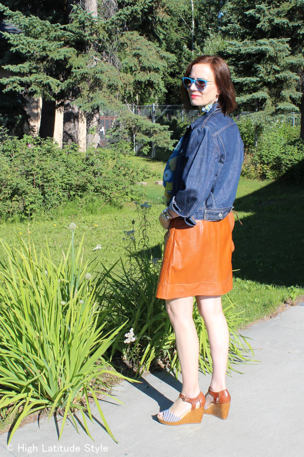 style book author in denim jacket tan skirt stripes floral print scarf