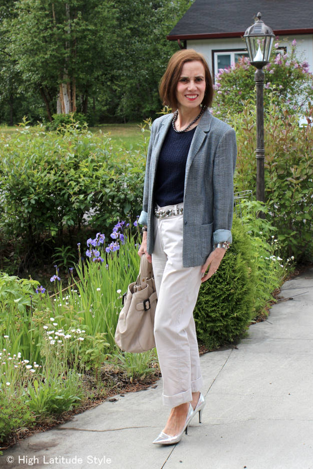midlife woman in work look with blazer and chinos (side view)