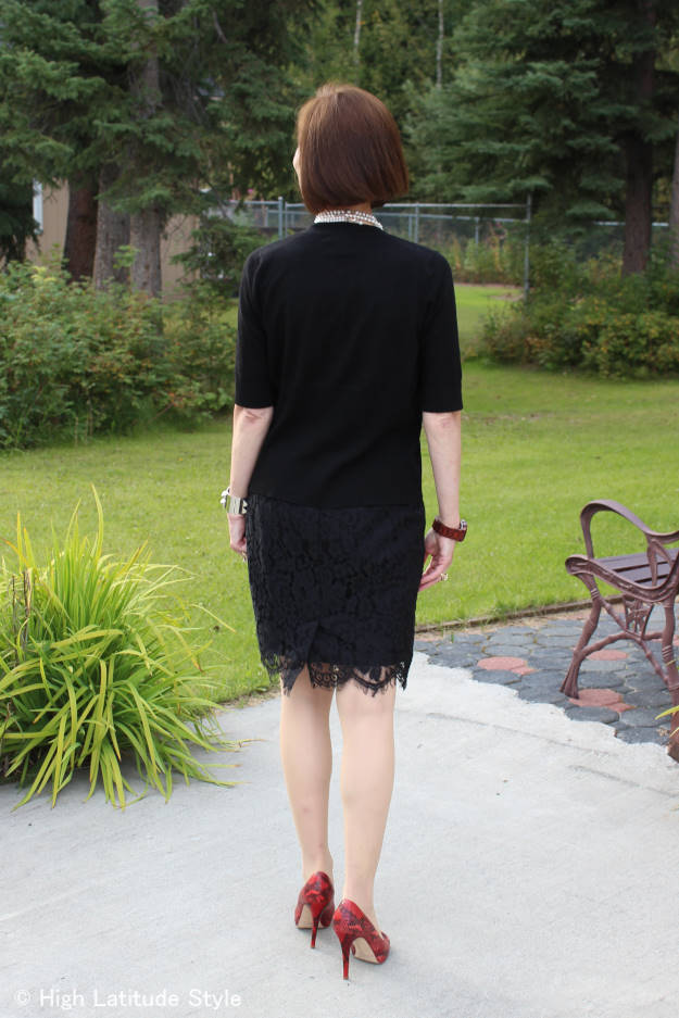 midlife woman in posh chic cardigan with lace skirt