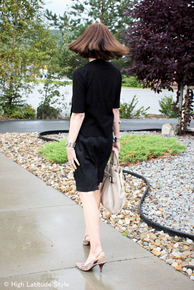 #advancedstyle woman in short sleeve cardigan with skirt
