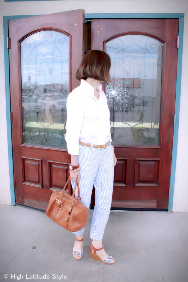 Nicole in casual vacation outfit with pants and a button-down shirt