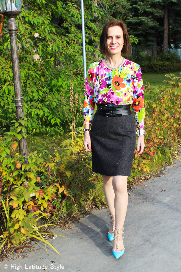 stylist featuring an unusual combination of tweed skirt and with printed top