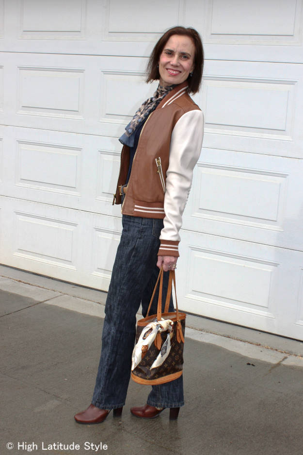 baseball jacket outfit with jeans